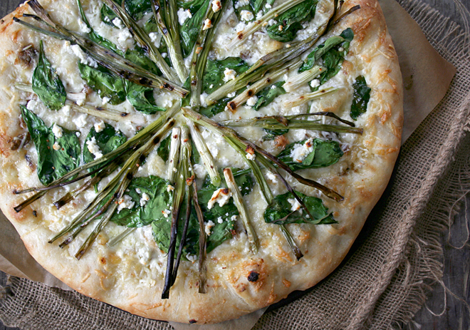 Roasted Garlic Pizza Topped with Grilled Onions, Spinach, and Feta Cheese