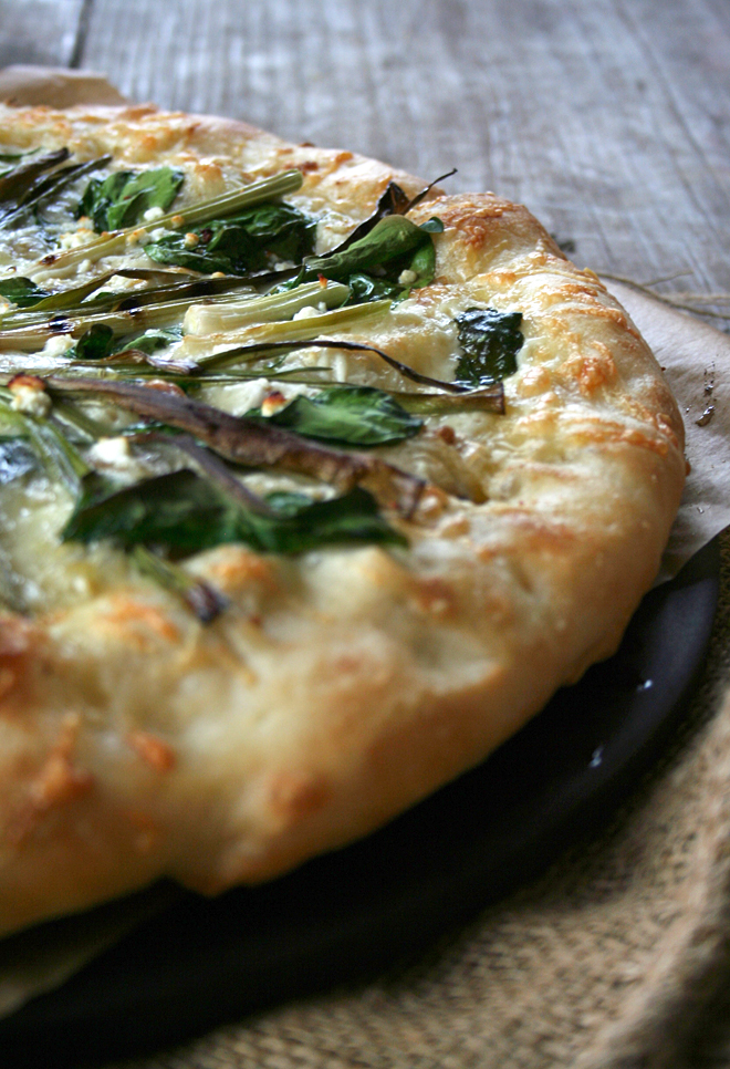 Roasted Garlic Pizza Topped with Grilled Green Onions, Spinach, and Feta Cheese